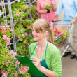 Florist woman make inventory at garden store — Stock Photo