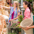 Garden center salesman selling pot to customer — Stock Photo #12060391