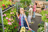 Woman shopping for flowers in garden shop — Stock Photo
