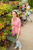 Woman at garden center shopping for flowers — Stock Photo