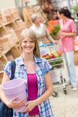 Woman hold flower pot garden centre store — Stock Photo