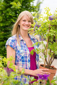 Woman hold tree plant at garden center — Stock Photo
