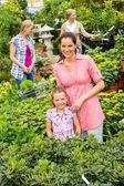 Mother daughter shopping flowers in garden center — Stock Photo