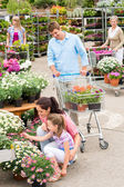 Garden center family shopping flowers — Stock Photo