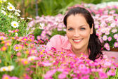 Portrait beautiful woman with pink daisy flowers — Stock Photo