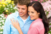Happy couple embracing in nature garden — Stock Photo