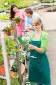 Florist at garden center retail inventory — Stock Photo