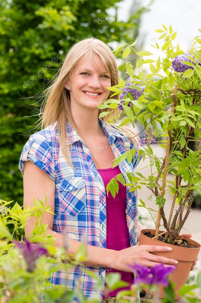 Smiling woman hold tree plant at garden centre shopping — Stock Photo #12060159