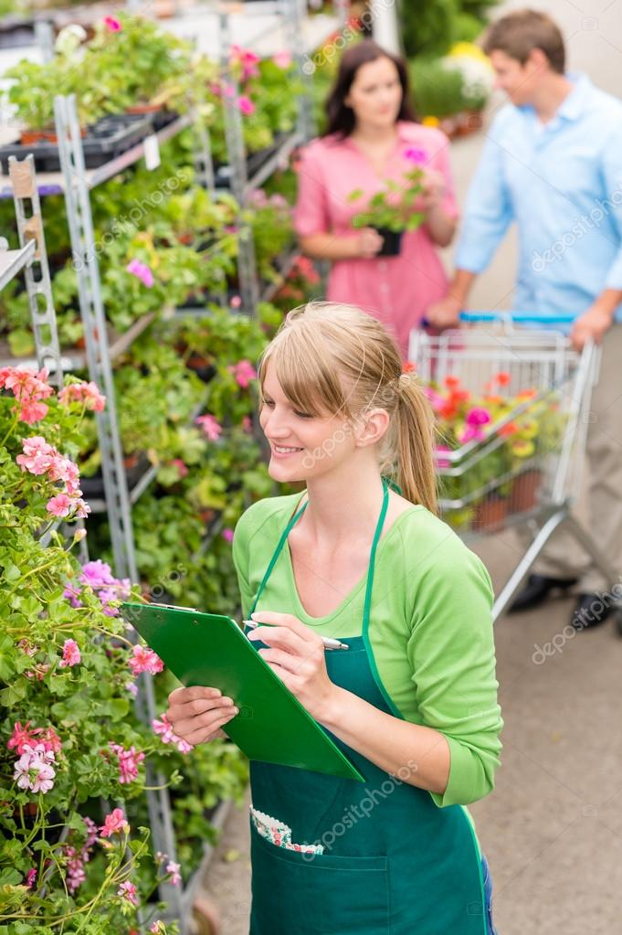 Happy florist woman make inventory at garden shopping center — Stock Photo #12060368
