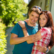 Young happy couple embracing in sunny park — Stock Photo #12447323