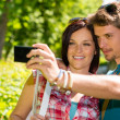 Young couple in love take picture themselves — Stockfoto