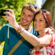 Young couple in love take picture themselves — Photo