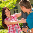 Young playful couple smiling in sunny park — Stockfoto