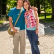Stock Photo: Young man and woman tourist smiling