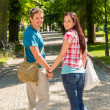 Foto Stock: Love couple enjoy walking in sunny park