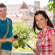 Young woman holding map man with camera — Stock Photo