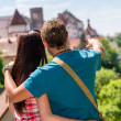 Young man pointing woman the castle architecture — Stock Photo #12447414