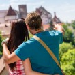 Young man pointing woman the castle architecture — Stock Photo