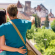 Young man showing woman the castle architecture — Stock Photo