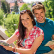 Stock Photo: Young happy couple on vacation with map
