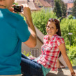 Young woman being photographed in romantic city - Stock Photo