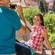 Young woman being photographed in romantic city — Stock Photo