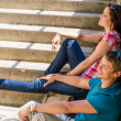 Young happy couple flirting on the stairs — Stockfoto