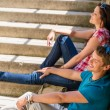 Young happy couple flirting on the stairs — Foto de Stock