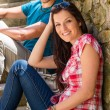 Young couple relax on stone stairs — Stock Photo