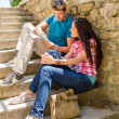 Young couple look city map sunny day — Stock Photo
