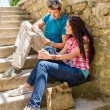 Young couple look city map sunny day — Stock Photo #12447472