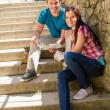 Young couple hold city map sunny day — Stockfoto
