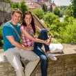 Young happy couple holiday portrait travel city — Stock Photo