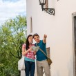 Couple with map pointing directions on vacation — Stock Photo