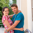 Happy young couple hugging outdoors smiling — Stock Photo
