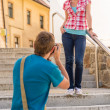 Young couple in city take photos — Stock Photo #12447550