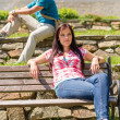 Young relax on park bench — Stock Photo