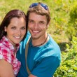 Young happy couple embracing in sunny park — Stock Photo #12447633