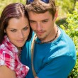 Happy affectionate young couple hugging in park — Stock Photo