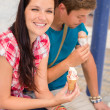 Young woman and man with ice cream - Stok fotoraf