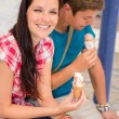 Young woman and man with ice cream - Stockfoto