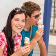 Young woman and man eat ice cream - Stock Photo