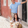 Young couple resting with dog on stairs — Stock Photo