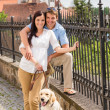 Young couple with dog at historical town — Stock Photo