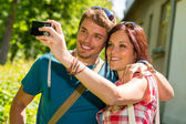 Young couple in love take picture themselves — Stock Photo