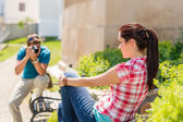 Young man take photo of his girlfriend — Stock Photo