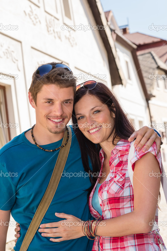 Young loving couple embracing and smiling holiday trip in city — Stock Photo #12447303