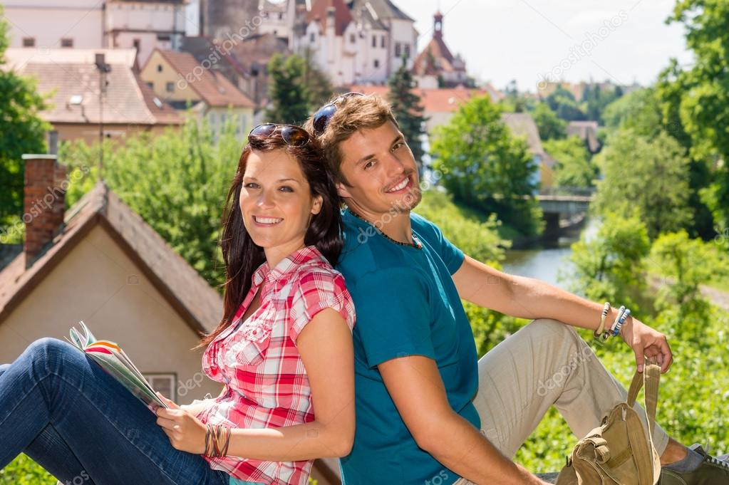 Young happy couple sitting city view smiling travel vacation — Stock Photo #12447422