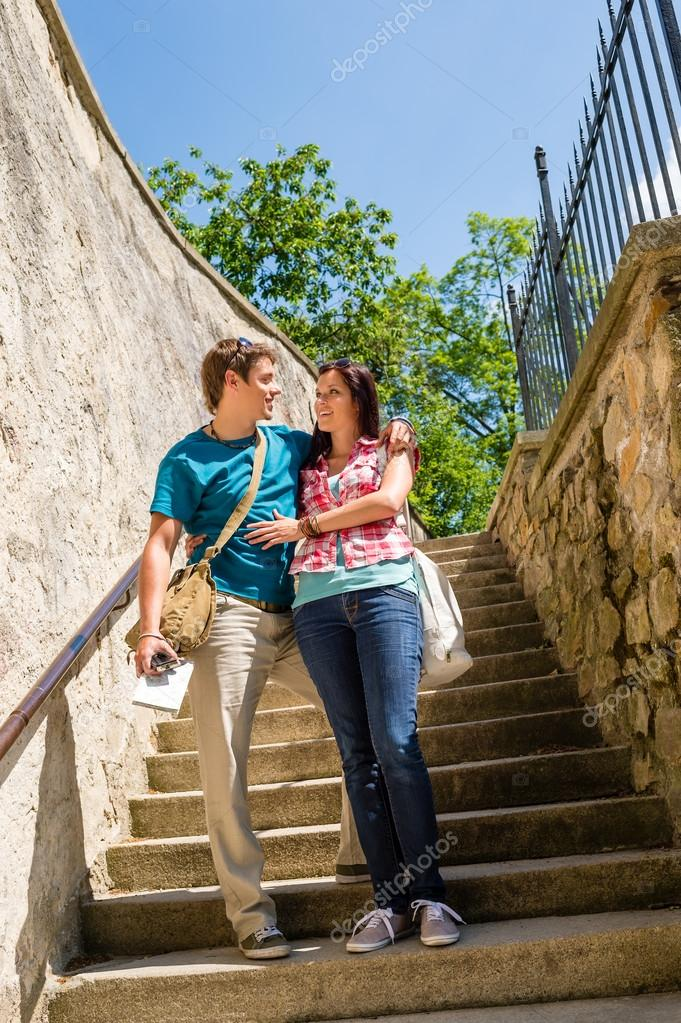 Young couple standing on stairs smiling looking at each other  Stock Photo #12447494