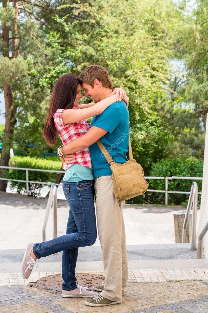 Affectionate young couple hugging looking at each other — Stock Photo #12447523